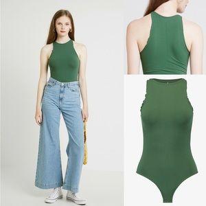 Free people NWOT green bodysuit med/large
